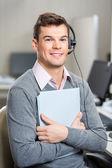 Young Customer Service Representative Holding File — Stock Photo