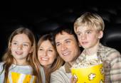 Happy Family Watching Film In Movie Theater — 图库照片