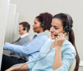 Female Customer Service Representative Talking On Headset — Stock Photo