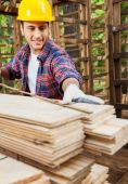 Worker Measuring Wooden Plank In Cabin At Site — Stock Photo