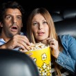 Shocked Couple Watching Movie In Theater — Stock Photo #74980539