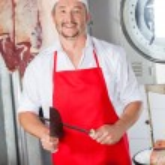 Butcher Sharpening Knife In Butchery — Stock Photo #76280861