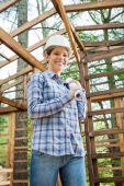 Happy Architect Holding Blueprint In Wooden Cabin — Foto de Stock