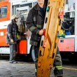 Portrait Of Confident Firefighter Holding Wooden Stretcher — Stock Photo #80164808