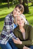 Woman Embracing Mother At Campsite — Stock Photo