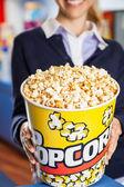Worker Holding Popcorn Bucket At Cinema — Stock Photo