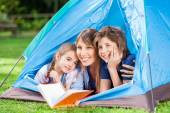 Children With Mother Holding Book In Tent — Stock Photo