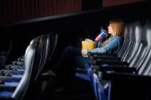 Woman Drinking Cola While Watching Movie At Theater — Stock Photo