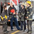 Portrait Of Confident Firefighter Standing With Team — Stock Photo #80672228