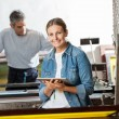 Female Worker Holding Digital Tablet At Paper Factory — Stock Photo #80672906