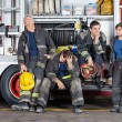 Team Of Tired Firefighters At Station — Stock Photo #80673210