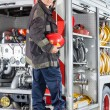 Fireman Standing On Truck At Fire Station — Stock Photo #81139914