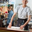 Confident Man Using Squeegee In Factory — Stock Photo #81643082