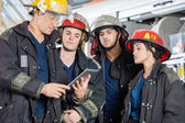 Firefighters Using Tablet Computer — Stock Photo