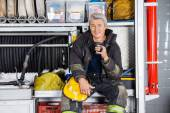Smiling Fireman Sitting In Truck At Fire Station — Stock Photo
