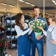 Salesgirls Assisting Male Customer In Buying Flower Plants — Stock Photo #82002322