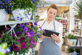Woman Using Digital Tablet In Flower Shop — Stock Photo