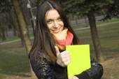 Student in the park with a folder — Stock Photo