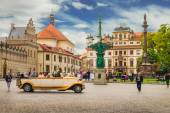 And old timer car driving through Hradcany square in Prague, May 23, 2015 — Stock Photo
