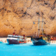 Cruise ships full of tourists anchored at Navagio beach, Zakynthos island, Greece - July 13, 2015 — Stock Photo #78112678