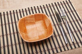 Bowl and cutlery on the table — Stock Photo