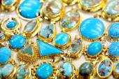 Golded jewel with turquoise — Stock Photo