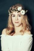 Cute woman with fair hair and flowers — Stock Photo