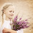 Young Girl Outdoors. Happy Girl with Heather Flowers in Great Br — Stock Photo #76970077