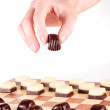 Hand holding chocolate candy — Stock Photo #69715147