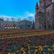 Medieval european church with flowerbed outside — Stock Photo #69715401