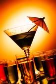 Multi-coloured shots and martini glass — Stock Photo