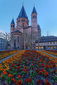 Medieval european church with flowerbed outside — Stock Photo