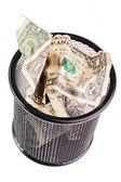 Dollars in a trash bin — Stock Photo