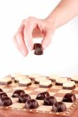 Hand holding chocolate candy — Stock Photo