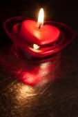 Heart shaped red candle — Photo