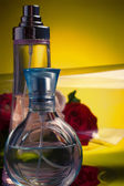 Perfume bottles with  roses — Stock Photo