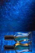 Perfume bottles isolated on blue — Stock Photo