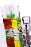 Glasses filled with multicoloured alcohol drinks — 图库照片