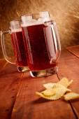 Beer mugs and potatoe chips  — Stock Photo
