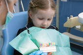 The child dental picks colored fillings — Stock Photo