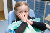 The little girl examined on the dental clinic — Stock Photo