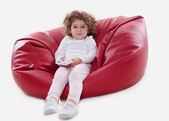 The child sitting on the furniture frame less isolated — Stock Photo