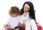 The child hold a book with mother isolated — Stock Photo