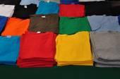 Folded t-shirts — Stock Photo