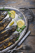 Mackerels on silver plate — Stock Photo
