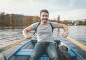 Man rowing on the river — Stock Photo