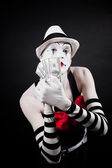 Theatrical mime with dollars in their hands  — Stock Photo
