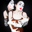 Mime men tempts women — Stock Photo #57378567