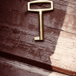Old lost key on floorboards  — Stock Photo #63134965