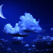 Big moon and stars in a cloudy night blue sky — Stock Photo #63135151